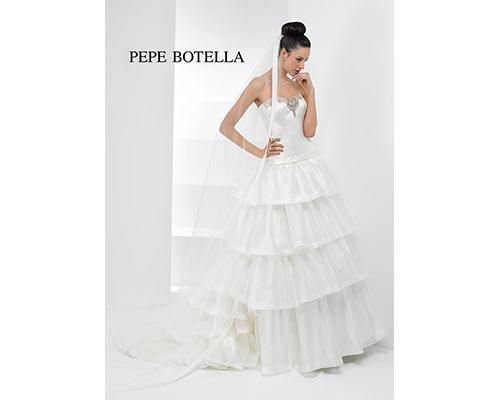 Vestido de novia con falda con volantes