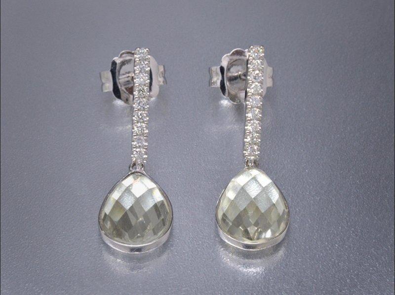 Pendientes de oro blanco, diamantes y Topacio incoloro