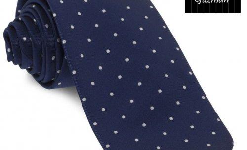 Corbata azul marino de topos blancos